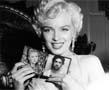 N-1179 Not everybody knows that the real name of Marilyn Monroe is Norma Jean Mortenson. During the World War II she worked at a military factory, which produced airplanes and spare parts to them. In this collage she is holding two of your pictures in her hands.