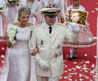 N-791 Albert II, Prince of Monaco, with his fiancee Charlene Lynette Wittstock and your photograph in his hand at their wedding ceremony. That's how your photo frame is going to look like this time. Hopefully you will like it.
